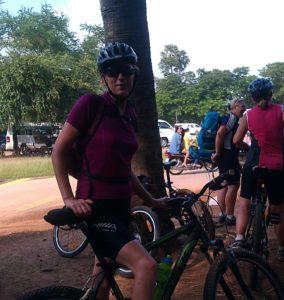Jane on bike in Cambodia